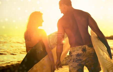 Young Couple going surf