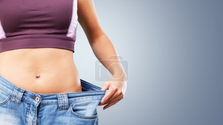Photo for Weight Loss Woman, isolated on  background - Royalty Free Image