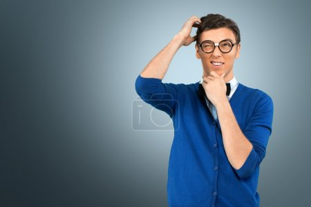 Young nerd man posing