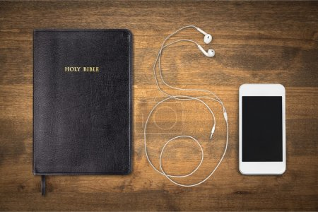 Holy Bible book and smartphone