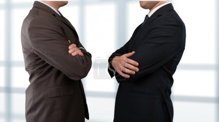 Businessmen in Business Suits with Crossed Arms