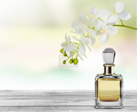 Photo for Perfume bottle and flowers isolated on white background. - Royalty Free Image