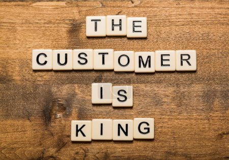 King. The Customer is King card with colorful background with defocused lights