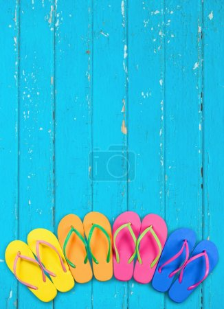 Summer. Flip flops with blue decking
