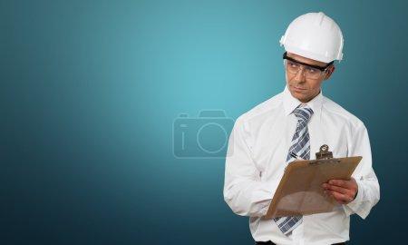 Photo pour Inspecteur, osha, presse-papiers. - image libre de droit
