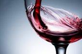 Stream of wine being pouring into a glass closeup, wine, splashing, splash,