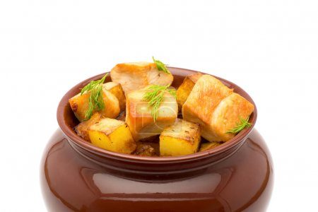 Photo for Fried potatoes with chunks of meat in a clay pot on a white background - Royalty Free Image