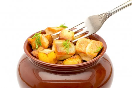 Photo for Fried potatoes with chunks of meat in a pot with a fork on a white background - Royalty Free Image