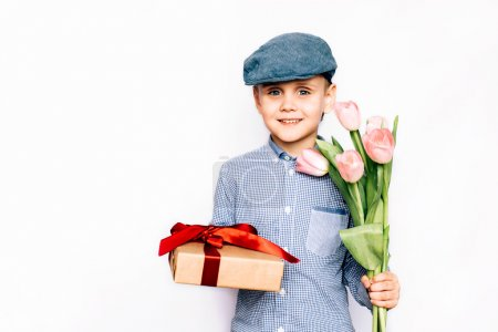 boy gives flowers and a gift