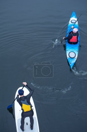Group of athletes kayaking on the river03