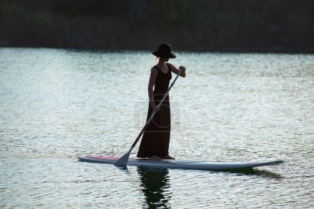 silhouette of a beautiful woman on stand up paddle board. SUP02