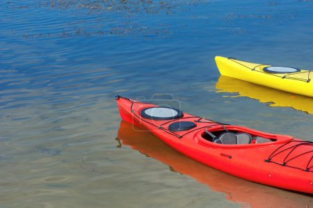 Pair of single kayaks in a row