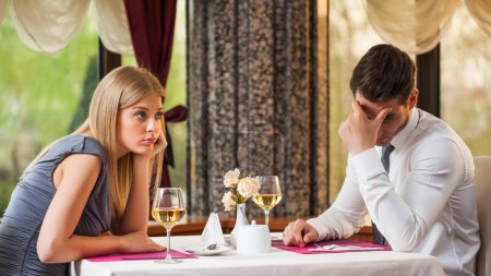 Photo for Young couple is getting bored on first date - Royalty Free Image