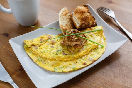 Denver omelet with toasts and fried onion