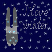 Greeting card with cute bunny in scarf and hats on navy colored background with light blue snowflakes and calligraphic lettering I love winter