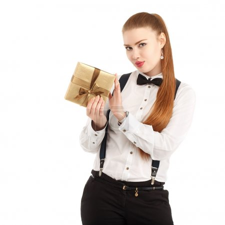 Portrait of beautiful young woman in strict clothing with bow ti