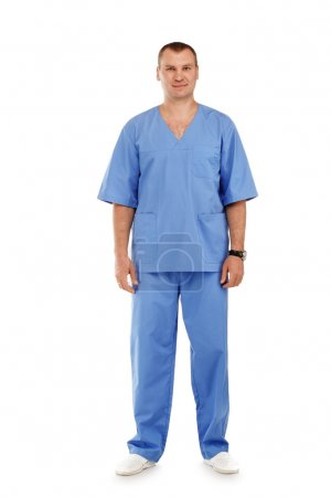 Full length portrait of a young male doctor in a medical surgica