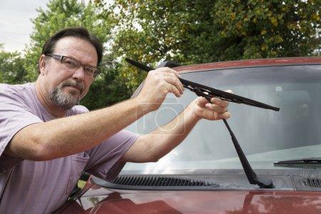 Mechanic Taking Worn Wiper Blade Off