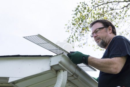 Handyman Installing Gutter Guards