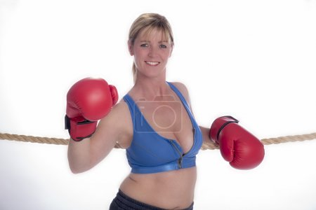 Blond attractive female boxer with red gloves