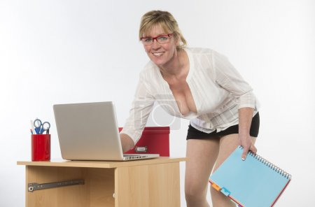 Secretary working with a computer on her desk