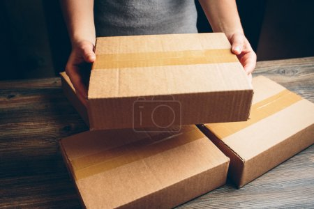 Photo for Package on the table. - Royalty Free Image
