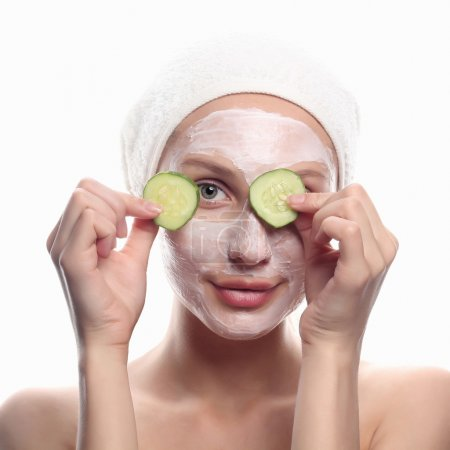 young woman with cucumber mask