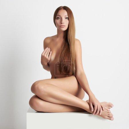 sexy girl sits like a mermaid