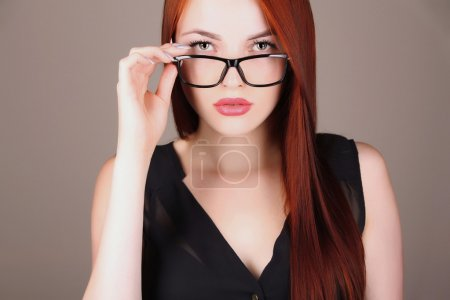 Beautiful business woman in glasses