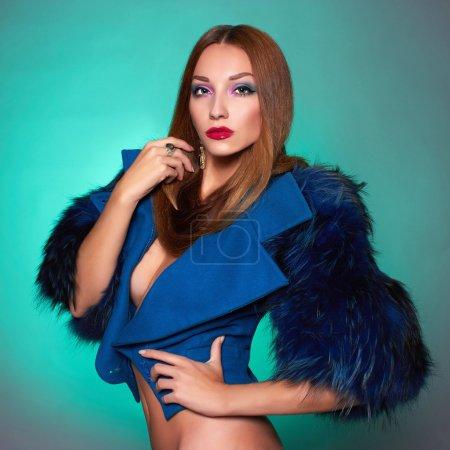 Beautiful woman in blue fur