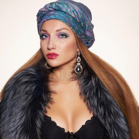 sexy woman in fur and arabic turban