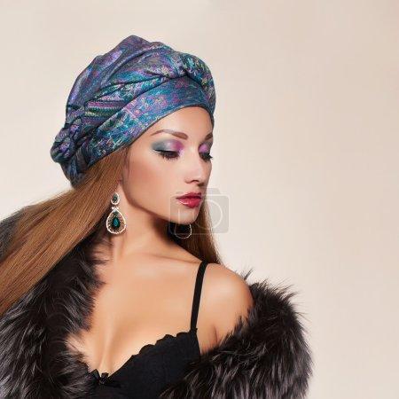 Beautiful woman in fur,jewelry and turban