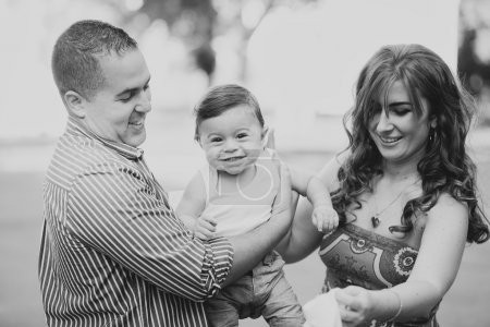 Black and white Image of happy family of three