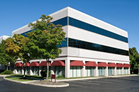 White Building with Red Awnings