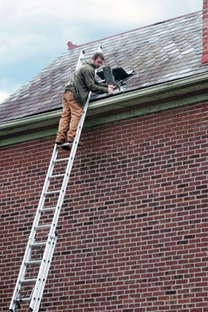 Roof Worker on Ladder