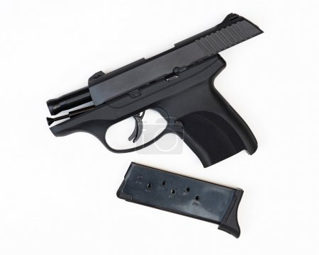Photo for 9mm hand gun in safe mode with slide locked back & empty magazine removed. - Royalty Free Image