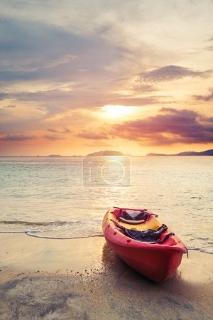 Kayak on the beach in sunset