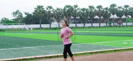 Photo for Asian woman athlete running on track - Royalty Free Image