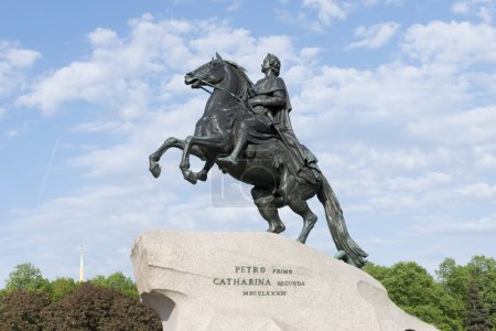 """Monument to Peter 1, """"the bronze horseman"""" in the background the spire of the Admiralty"""