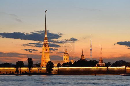 Peter and Paul fortress view from the Palace embankment of the Neva river at sunset during the white nights in St. Petersburg.