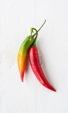 Fressh chilli peppers on wood background