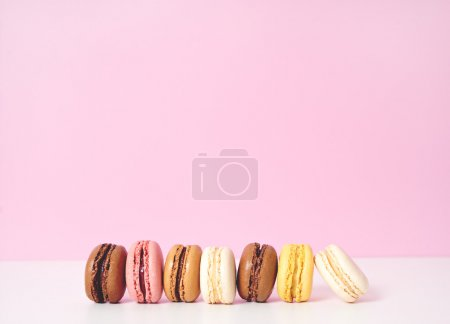 Photo for Some  macaroons lying on pink background - Royalty Free Image