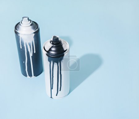 black and white spray paint bottle
