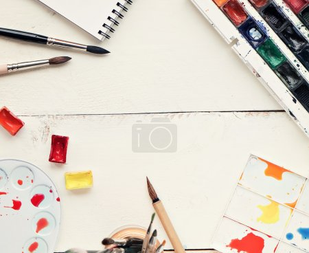 painter workplace with watercolor pallete anr other tools