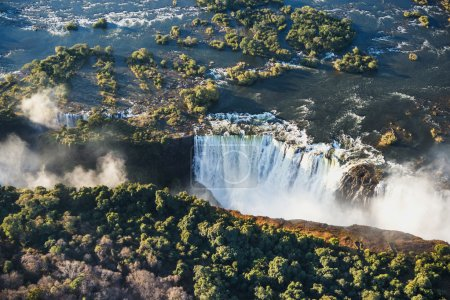 Photo for Victoria Falls and the surrounding area in Mosi-oa-Tunya National park in Zambiya. World Heritage Site, helicopter view - Royalty Free Image