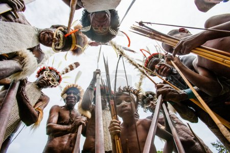 Men of the tribe with bows and spears