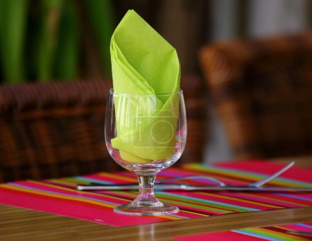 Green  napkin in a glass