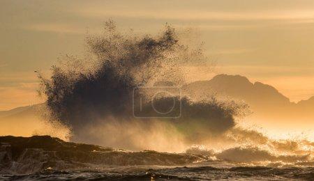 Waves crashing on rocky seashore