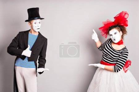 Your text here.  Colorful studio portrait of mimes with gray background. April fools day