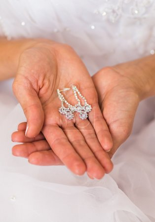 earrings on a female hand